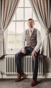 dapper-chaps-dark-grey-lounge-suit-pink-chech-waistcoat-blush-pink-tie